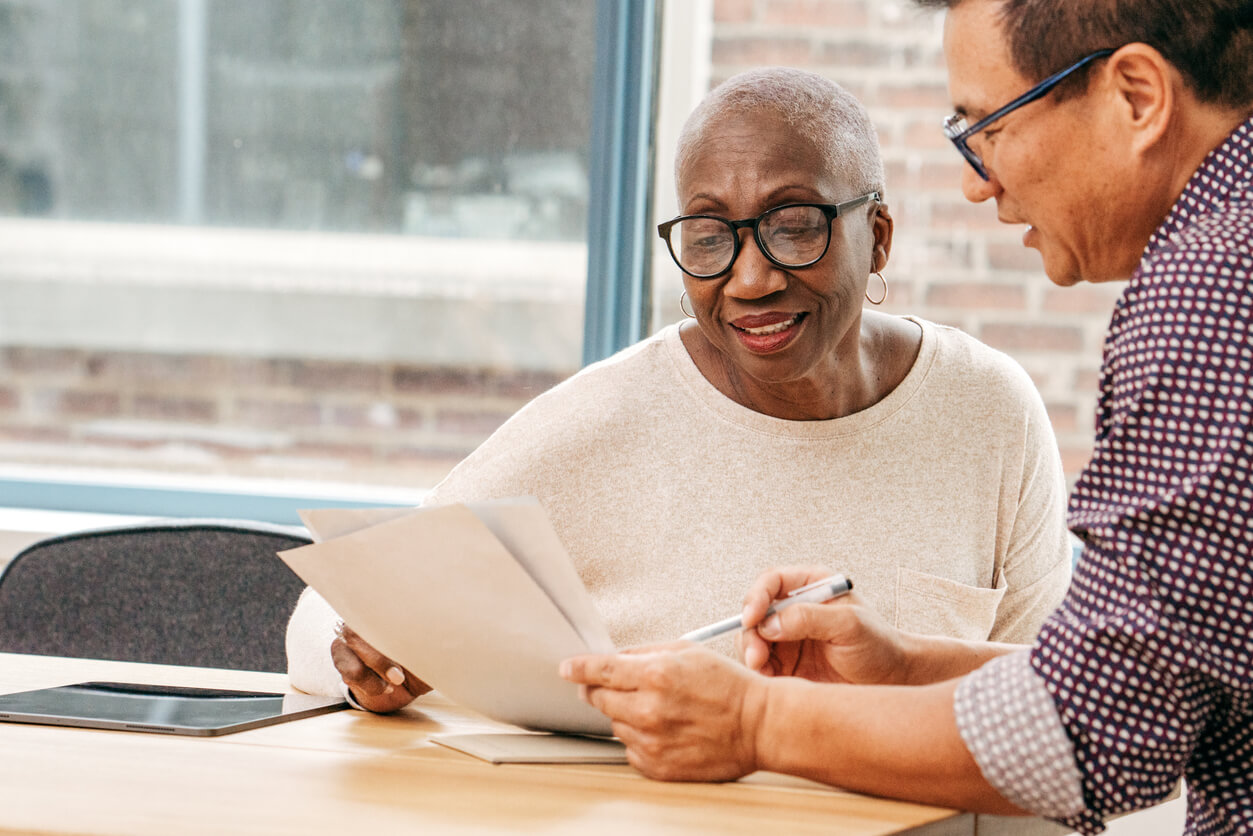 Woman reviewing her estate plan with attorney
